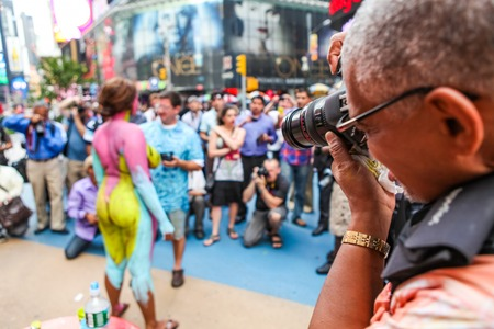 NEW YORK, USA - SEPTEMBER 19, 2011: Unidentified bodypainted woman by the artist Andy Golub at Times Square in New York. Golub is free to paint fully nude models in the public streets of New York City at any time of day