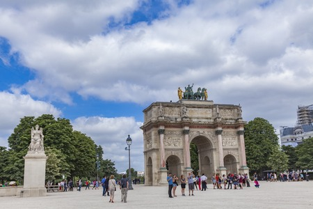 PARIS, FRANCE - JUNE 16, 2017: Unidentified people by Arc de Triomphe du Carrousel in Paris, France. It was built between 1806 and 1808 to commemorate Napoleons military victories