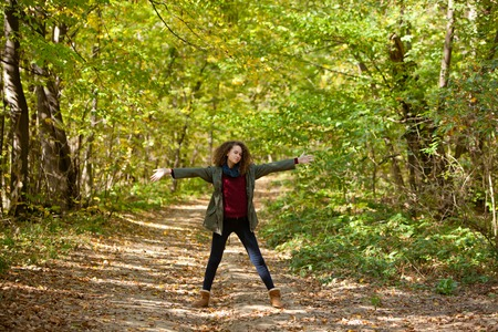 Teen girl walking and relaxing in autumn  forest