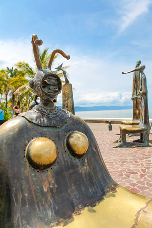 PUERTO VALLARTA, MEXICO - SEPTEMBER 6, 2015: The Roundabout of the Sea sculputers in Puerto Vallarta in Mexico. Sculpure was made by Alejandro Colunga from 1996, Imagens