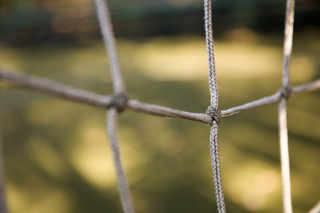 Closeup detail of the football net in the field