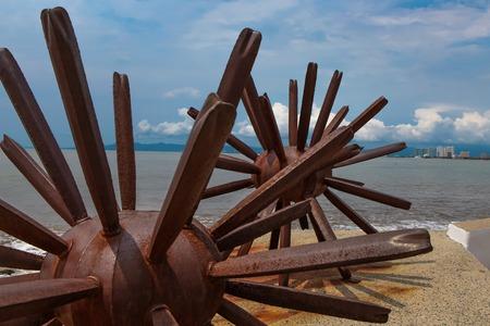 PUERTO VALLARTA, MEXICO - SEPTEMBER 6, 2015: Two Sea Urchins statues in Puerto Vallarta in Mexico. Sculpure was made by Blu (Maritza Vazquez) at 2007 Editorial