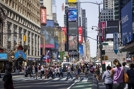 NEW YORK, USA - AUGUST 26, 2017: Unidentified people on the Times Square, New York. Times Square is the most popular tourist location in New York City.