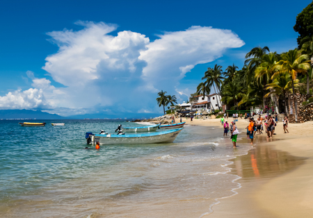 PUERTO VALLARTA, MEXICO - SEPTEMBER 10, 2015: Unindentified people at Playa Las Animas in Mexico. It is a beautiful beach in the southern zone of Puerto Vallarta. Editorial