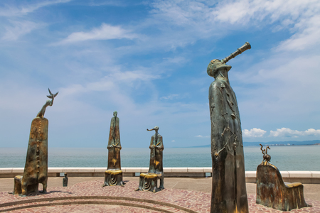 PUERTO VALLARTA, MEXICO - SEPTEMBER 6, 2015: The Roundabout of the Sea sculputers in Puerto Vallarta in Mexico. Sculpure was made by Alejandro Colunga from 1996, Editorial