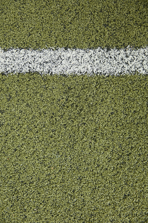 Closeup detail of the white line on artificial grass