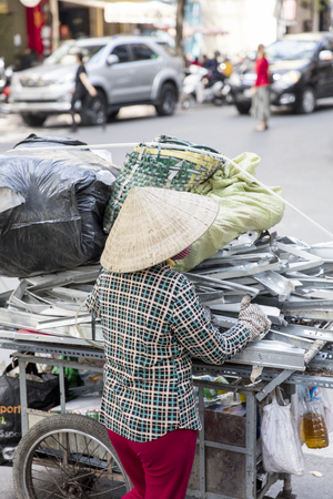 HO CHI MINH, VIETNAM - FEBRUARY 22, 2017: Unidentified woman on street of Ho Chi Minh, Vietnam. Ho Chi Minh is the largest city in Vietnam. Editorial