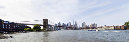 NEW YORK, USA - AUGUST 27, 2017:  View at Brooklyn bridge in New York. Brooklyn Bridge is a hybrid cable-stayed-suspension bridge with approximately 4000 pedestrians and 3000 cyclists cross this historic bridge each day.