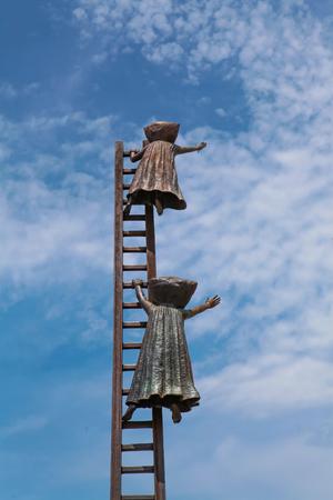 reason: PUERTO VALLARTA, MEXICO - SEPTEMBER 6, 2015: Searching for Reason statue at Puerto Vallarta, Mexico. Sculpure was made by Sergio Bustamante in 2000. Editorial