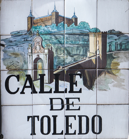 MADRID, SPAIN - MARCH 14, 2016: Closeup of the Madrid street sign. Street signs in Madrid are hand-painted ceramic tiles typically composed within 9 or 12 tiles. They depict the name of the alley or street.