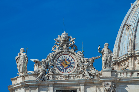 Clock on facade of Saint Peter basilica in Vatican, Rome, Italy Editorial