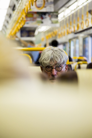 KYOTO, JAPAN - OCTOBER 8, 2016: Unidentified man in train of Japan Railways Group. This group maintains a Japanese nationwide railway network