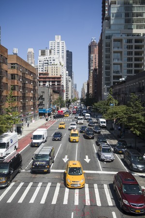 NEW YORK, USA - AUGUST 30, 2017: Unidentified people on the street of New York, USA. With more tha 8 million citizens it  is the most populous city in the United States. Sajtókép