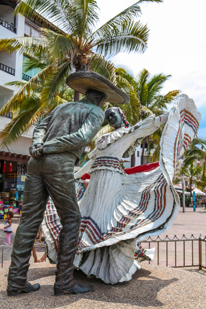 PUERTO VALLARTA, MEXICO - SEPTEMBER 6, 2015: Vallarta Dancers statue in Puerto Vallarta, Mexico. Sculpure was made by Jim Demetro at 2006