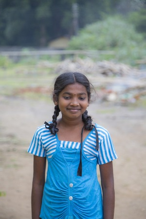 MATALE. SRI LANKA - JANUARY 27, 2014: Unidentified schoolgirl at the street of Matale, Sri Lanka. At Sri Lanka Education is state funded and offered free of charge at all levels. Editorial