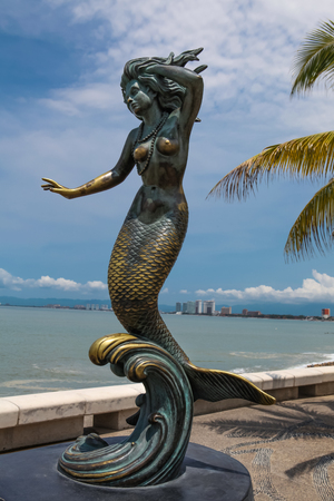 PUERTO VALLARTA, MEXICO - SEPTEMBER 6, 2015: Triton and Nereida sculpture at Puerto Vallarta,  Mexico. Sculpure was made by Carlos Espino at 1990 Editorial