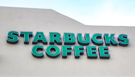 CABO SAN LUCAS, MEXICO - AUGUST 10, 2014: Detail of the Stabucks coffee in Cabo San Lucas, Mexico. It is an American global coffee company and coffeehouse chain founded at 1971.