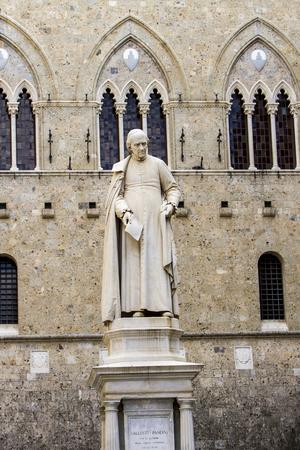 Statue of Sallustio Bandini at Piazza Salimbeni in Siena, Italy Фото со стока