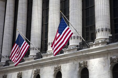View at flags wave outside the New York Stock Exchange, New York, USA