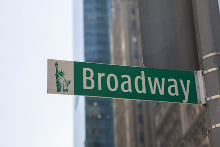 Street sign on Broadway on bright day, New York, United States