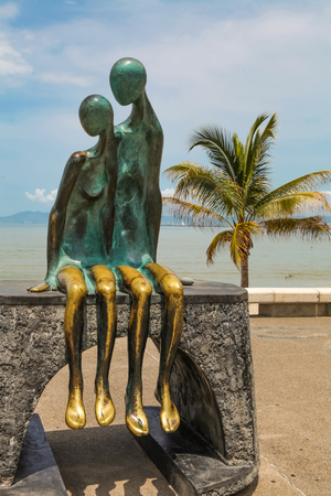 PUERTO VALLARTA, MEXICO - SEPTEMBER 6, 2015: View at La Nostalgia statue at Puerto Vallarta in Mexico. It was made by Jose Ramiz Barquet in 1984