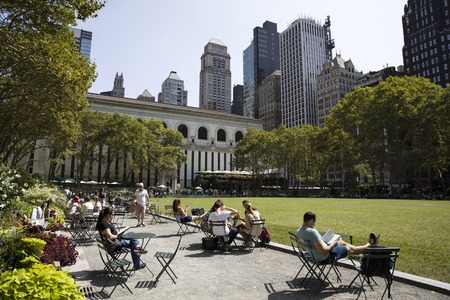 NEW YORK, USA - AUGUST 26, 2017: Unidentified people in Bryant Park in New York. Bryant Park is public park where in 1853 the Exhibition of the Industry of All Nations take place.