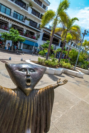 PUERTO VALLARTA, MEXICO - SEPTEMBER 6, 2015: Searching for Reason statue at Puerto Vallarta, Mexico. Sculpure was made by Sergio Bustamante in 2000. Editorial