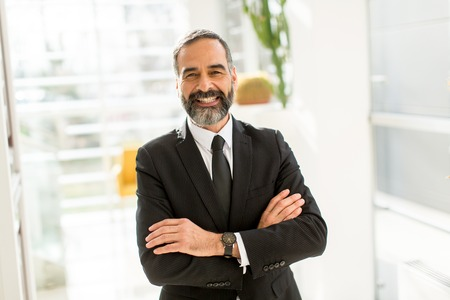 Portret of bearded handsome businessman in office Stock Photo