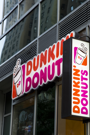 NEW YORK, USA - AUGUST 31, 2017: Detail of the Dunkin Donuts store in New York. It is an American global donut company and coffeehouse founded at 1950.