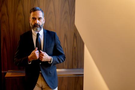 Portret of bearded handsomemiddle-aged  businessman