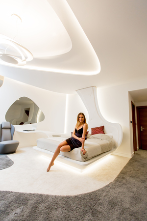 Pretty young woman relaxing in modern room 스톡 콘텐츠