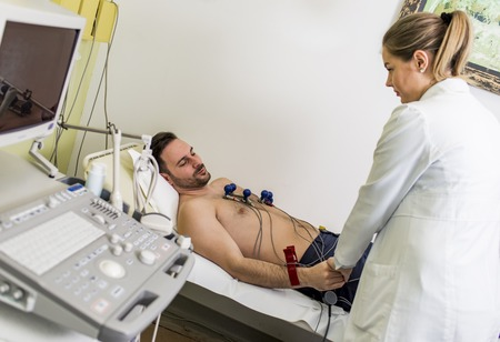 Young man doing preventive EKG in hospital