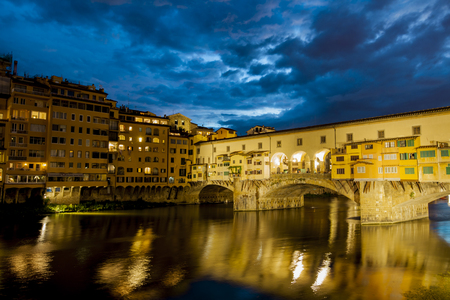 Night vew at Ponte Vecchio on Arno river in Florence, Italy