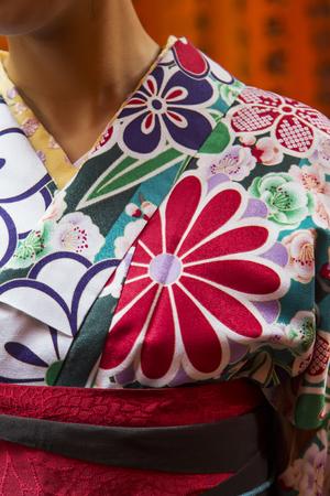 Traditional japanese female clothing at Fushimi Inari shrine in Kyoto, Japan