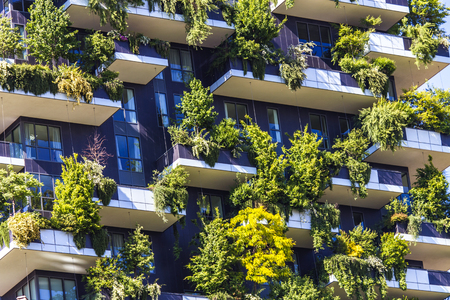 MILAN, ITALY - APRIL 28, 2017: Detail of the Bosco Verticale in Milan, Italy. It is a pair of residential towers in the Porta Nuova district of Milan that host more than 900 trees.