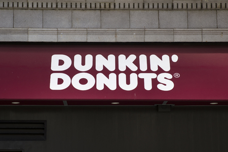 NEW YORK, USA - AUGUST 24, 2017: Detail of the Dunkin Donuts store in New York. It is an American global donut company and coffeehouse founded at 1950. Stock Photo - 93107336