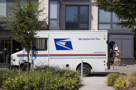 NEW YORK, USA - AUGUST 30, 2017: Detail of the US mail delivery truck in New York. US postal servise as independent agnecy was formed in 1971. Editorial