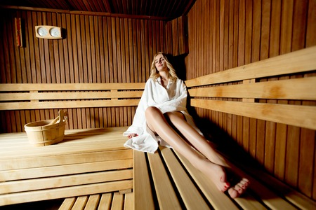 Beautiful woman relaxing a sauna