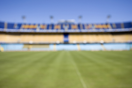 Defocused backdrop of the football stadium at daytime