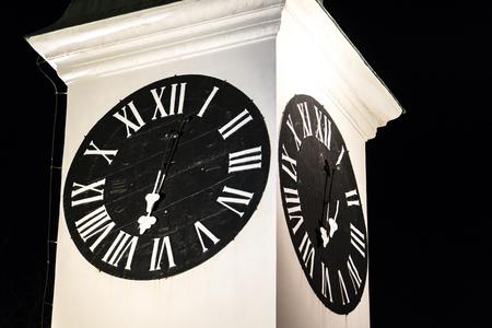 Old clock tower in Novi Sad, Serbia at night