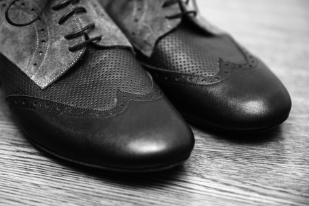 Closeup detail of the male tango shoes