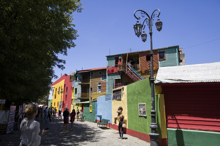 BUENOS AIRES, ARGENTINA - JANUARY 20, 2018: Unindentified people at Caminito street in La Boca, Buenos Aires, Argentina. This 100m long traditional alley full of colorful houses was one of biggest tourist hotspot in Buenos Aires. Editorial