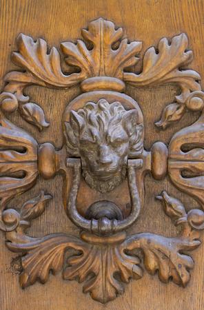Detail of the vintage door knocker from Montalcino, Italy 写真素材 - 95453947
