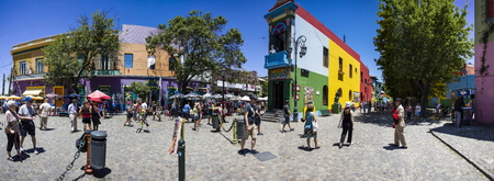 BUENOS AIRES, ARGENTINA - JANUARY 20, 2018: Unidentified people at Caminito street in La Boca, Buenos Aires, Argentina. This 100m long traditional alley full of colorful houses was one of biggest tourist hotspot in Buenos Aires.