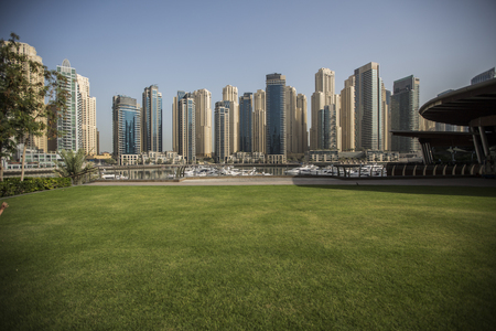 DUBAI, UAE - MAY 6, 2015: View at modern skyscrapers in Dubai Marina in Dubai, UAE. When the entire development is complete, it will accommodate more than 120,000 people. 에디토리얼