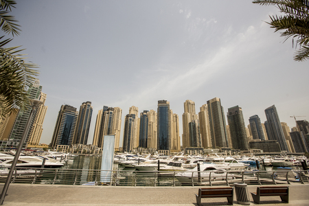 DUBAI, UAE - MAY 6, 2015: View at modern skyscrapers in Dubai Marina in Dubai, UAE. When the entire development is complete, it will accommodate more than 120,000 people. Editorial