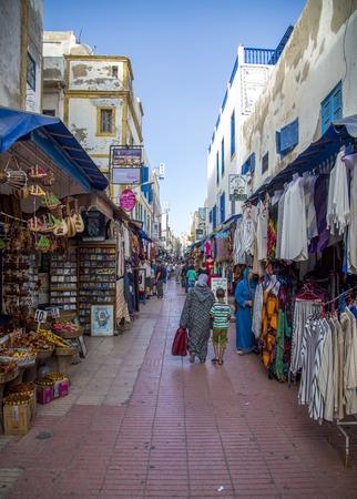 ESSAOUIRA, MOROCCO - SEPTEMBER 8, 2014: Unindentified people on the street of Essaouira, Morocco. Essaouira is a city in western Moroccan economic region of Marrakech-Tensift-Al Haouz, on the Atlantic coast. Editorial