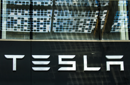 MILAN, ITALY -  APRIL 28, 2017: Detail from Tesla store in Milan, Italy. It is an American company that specializes in electric automotives founded at 2003.