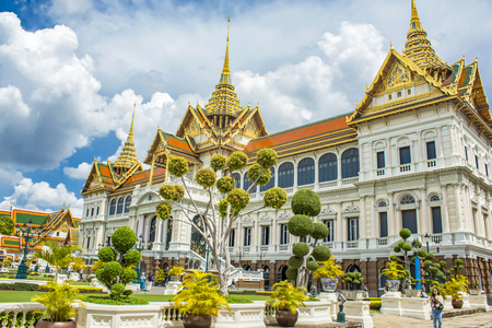 BANGKOK, THAILAND - AUGUST 21, 2014: Unidentified people by the Grand Palace in Bangkok. It is a complex of buildings and has been the official residence of the Kings of Siam since 1782.