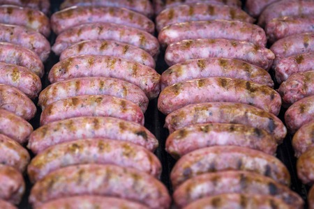 Close up view at grilling sausages on the barbecue
